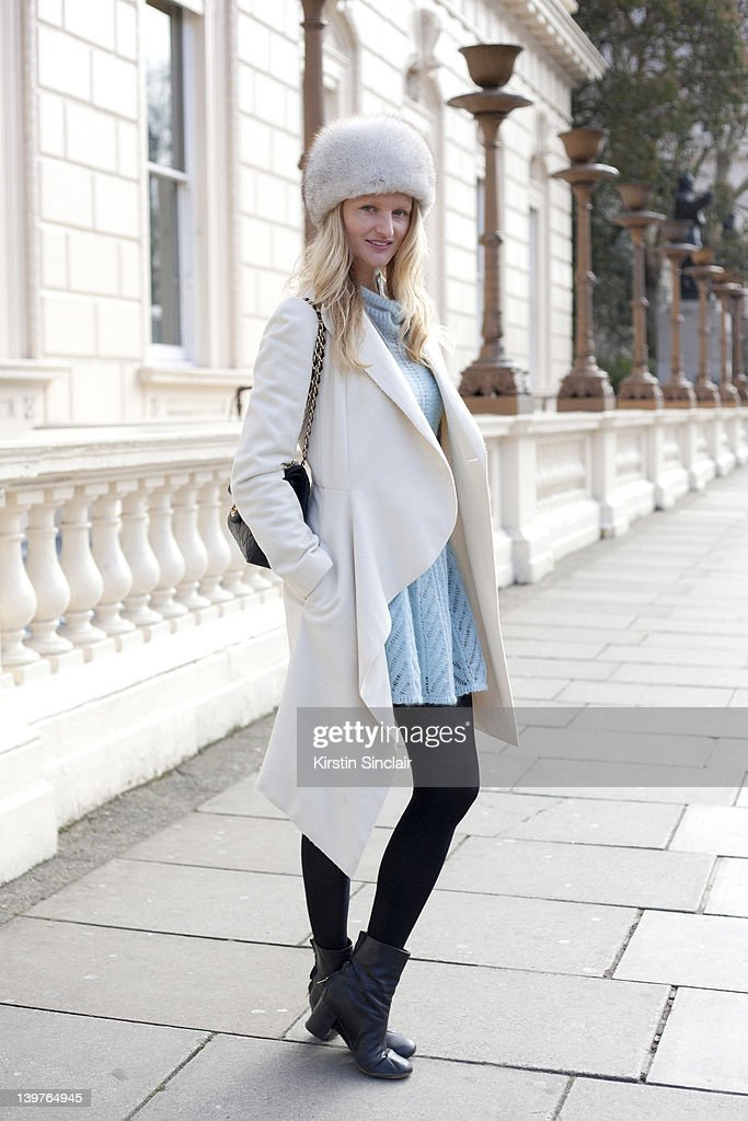 KINGDOM - FEBRUARY 21 Blogger and Photographer Candice Lake wearing Acne boots, Chanel bag and a Hat from Russia street style at London fashion week autumn/winter 2012 womenswear shows on February 21, 2012 in London, England.