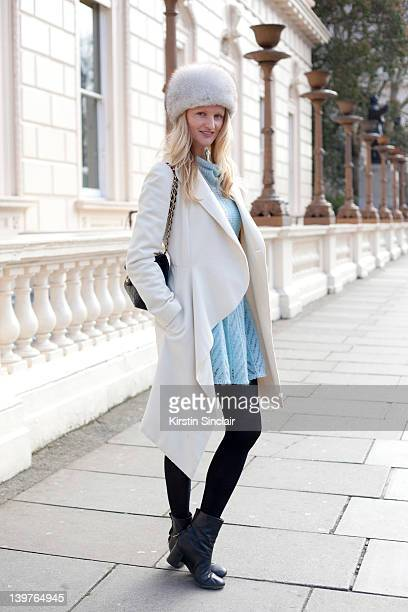 KINGDOM FEBRUARY 21 Blogger and Photographer Candice Lake wearing Acne boots Chanel bag and a Hat from Russia street style at London fashion week...