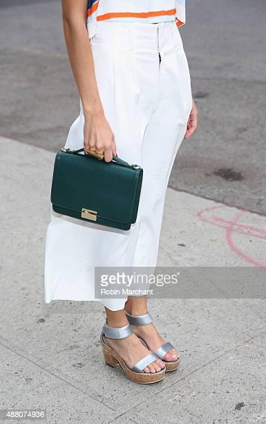 Blogger and stylist of A Vintage Vice @avintagevice Emma Sousa is wearing Elle Sasson top Apiece Apart Culottes Calvin Klein sandal Lauren Merkin bag...