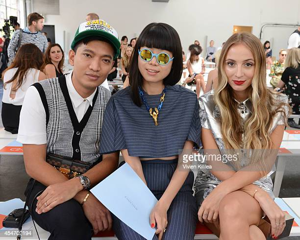 Blogger Bryanboy senior fashion editor of ELLE China Leaf Greener and model Harley VieraNewton attend the Tanya Taylor fashion show during...