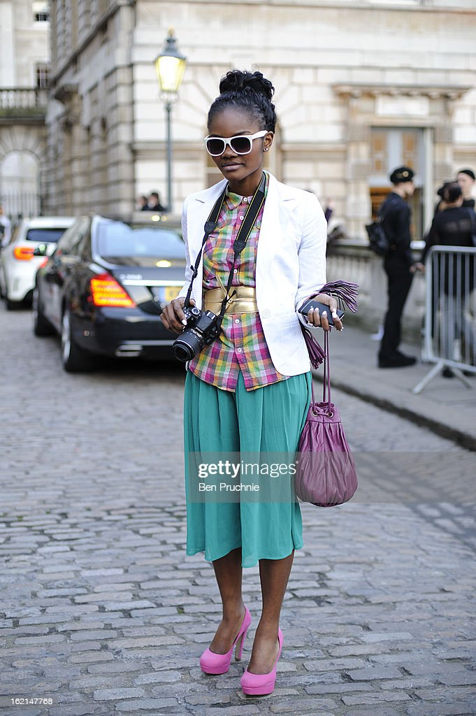 Blogger Cecile poses wearing an ASOS jacket with an unknown t-shirt with shoes and bag from Selfridges and glasses and belt from H+M at Somerset House during London Fashion Week on February 19, 2013 in London, England.
