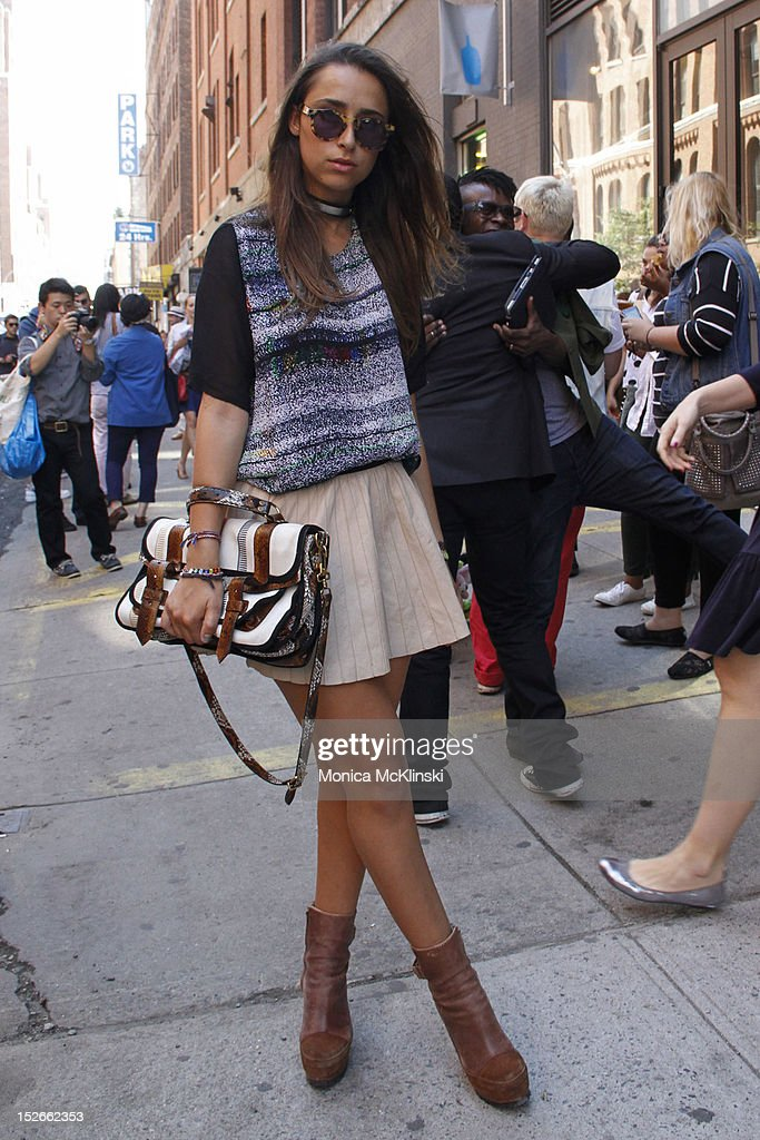 Blogger Chloe Wise seen wearing an Acne top and boots, Zara skirt, sunglasses and Proenza Schouler bag outside the Jeremy Scott showing at Milk Studios at Streets of Manhattan on September 12, 2012 in New York City.