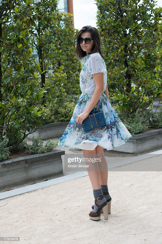 Blogger Doina Ciobanu wears YSL shoes, a Stella McCartney bag, Celine sunglasses and a Olga Blanc dress on day 3 of Paris Collections: Men on June 28, 2013 in Paris, France.