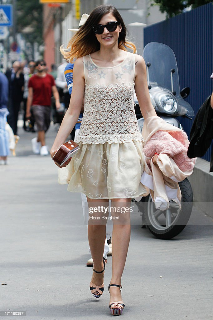 Blogger Eleonora Carisi is wearing a Red Valentino dress during Milan Fashion Week Menswear Spring/Summer 2014 on June 22, 2013 in Milan, Italy.