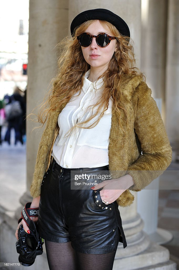 Blogger Emma Duprice poses wearing an assortment of vintage clothing at Somerset House during London Fashion Week on February 19, 2013 in London, England.