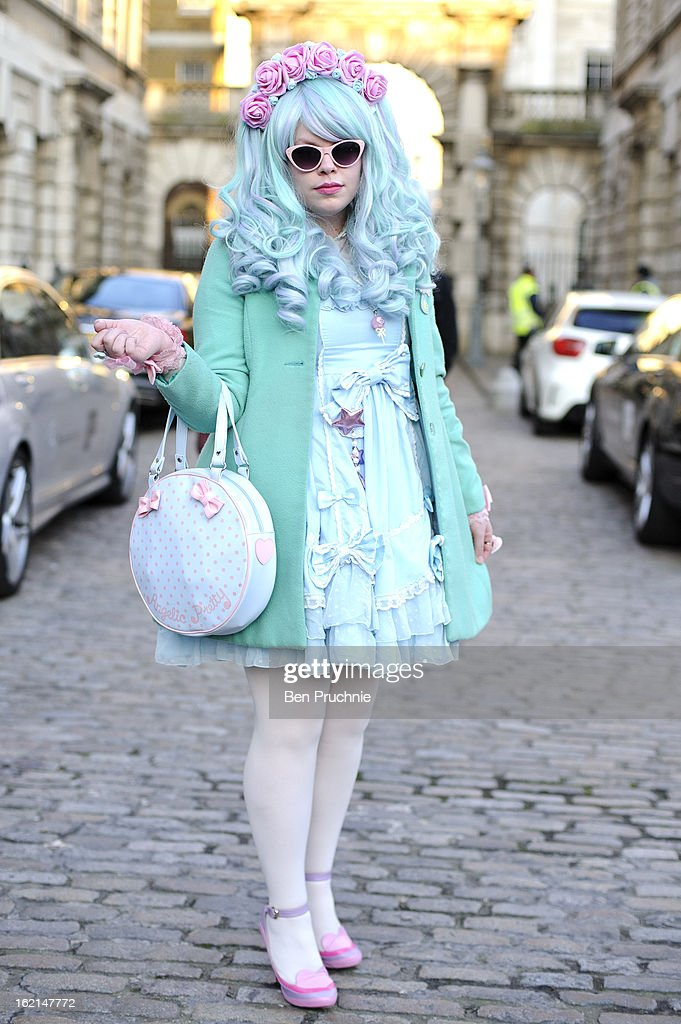 Blogger Florrie poses wearing a Body Line dress with an Oasis coat, hand made head dress, Luela shoes and an Angelic Pretty bag with jewellery from China town at Somerset House during London Fashion Week on February 19, 2013 in London, England.