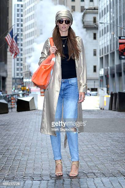 Blogger for wwwBONDmrktcom is seen wearing a GEORGINE gold silk trench coat turban and bag along with her own HM jeans Mark James by Badgley Mischka...