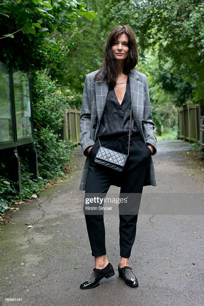 Blogger Hedvig Opshaug wears Unique by Top Shop blouse, Studio Nichollson trousers, Chanel bag, Jimmy Choo shoes and a Vanessa Bruno jacket on day 3 of London Fashion Week Spring/Summer 2013, on September 15, 2013 in London, England.