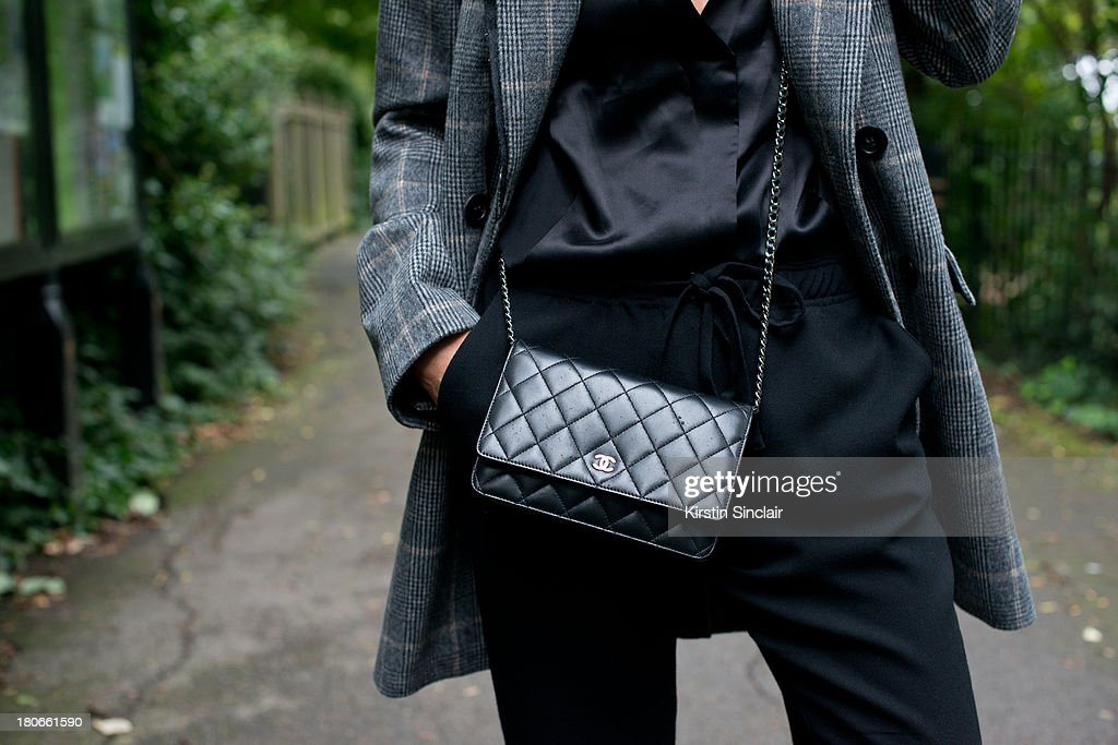 Blogger Hedvig Opshaug wears Unique by Top Shop blouse, Studio Nichollson trousers, Chanel bag and a Vanessa Bruno jacket on day 3 of London Fashion Week Spring/Summer 2013, on September 15, 2013 in London, England.