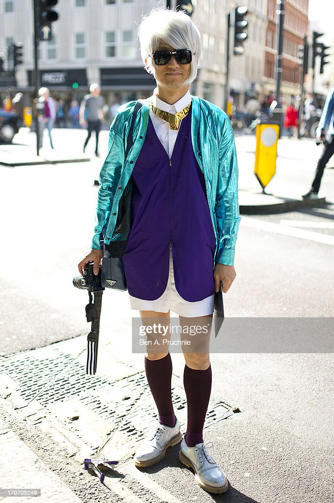 Blogger Jato (21) poses wearing Christopher Kane cardigan with a Yohji Yamamoto waistcoat at the Richard Nicoll catwalk presentation held during London Collection: MEN SS14 at The Old Sorting Office on June 16, 2013 in London, England.