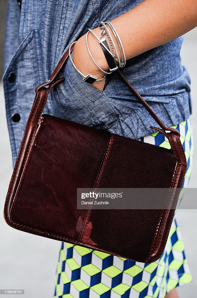 Blogger Jeanie Lau (purse detail) is seen outside the Pamela Gonzales presentation with a Desmo bag on September 4, 2013 in New York City.