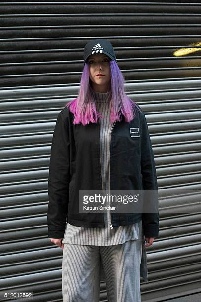 Blogger Kate White wears an Unalloyed jacket Zara top and trousers and an Adidas hat on day 5 during London Fashion Week Autumn/Winter 2016/17 on...