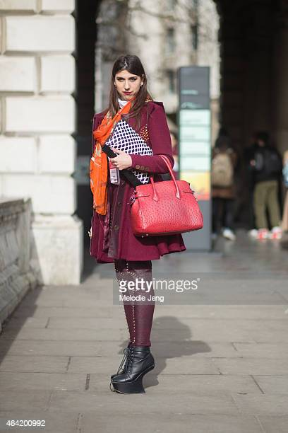 Blogger Kinga Kurek wears Carlotte Actis Barone jacket and leggingsa Cloudberry bag an Hermes scarf and Uniqlo top during London Fashion Week...