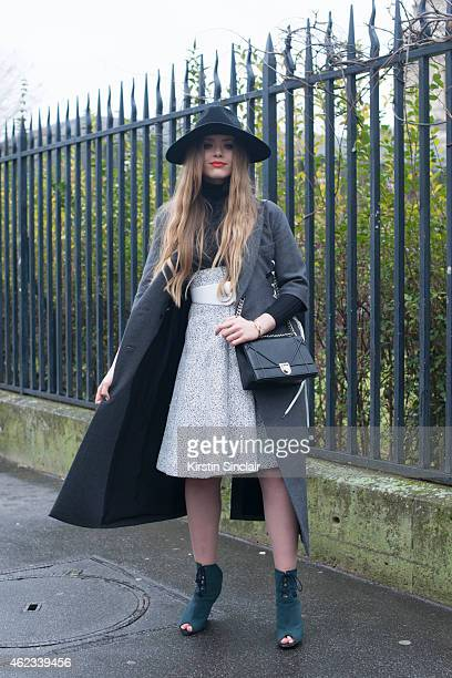 Blogger Kristina Bazan wears all Dior on day 2 of Paris Haute Couture Fashion Week Spring/Summer 2015 on January 26 2015 in Paris France