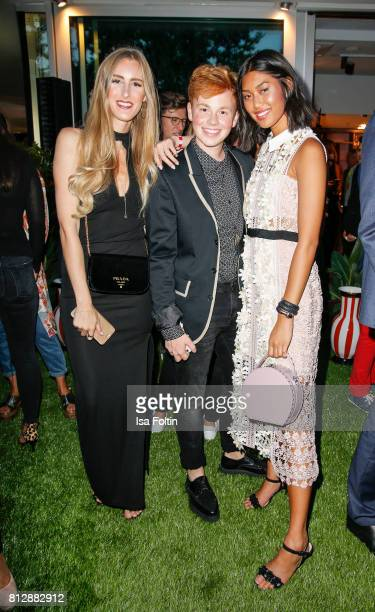 Blogger Leslie Huhn Blogger Erik Scholz and model and influencer Anuthida Ploypetch during the 'True Berlin' Hosted By Shan Rahimkhan on July 11 2017...