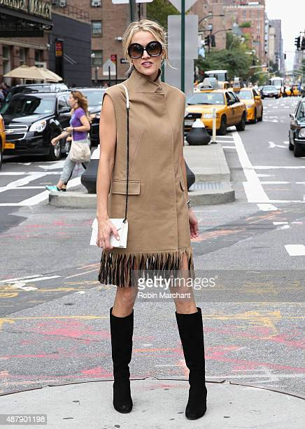 Blogger Lyndsey Zorich of L Avenue @lyndseyzorich is wearing dress by Phillip Lim boots by Yves Saint Laurent bag by Yves Saint Laurent and glasses...