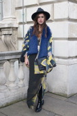 Blogger Naomi Rowland wears a Boohoo hat and shoes Daisy Darche faux fur scarf kimono and skirt Noonday jewellery and bag unknown on day 2 of London...