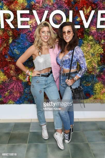 Blogger Natasha Oakley and model Devin Brugman attend the #REVOLVEfestival at Coachella with Moet Chandon on April 16 2017 in La Quinta CA Merv...