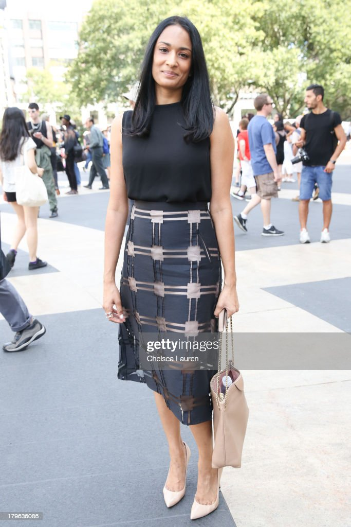 Blogger Prianka Patel is seen wearing a Tibi skirt, Theory shirt, Stuart Weitzman shoes and a Marc Jacobs purse on the Streets of Manhattan on September 5, 2013 in New York City.