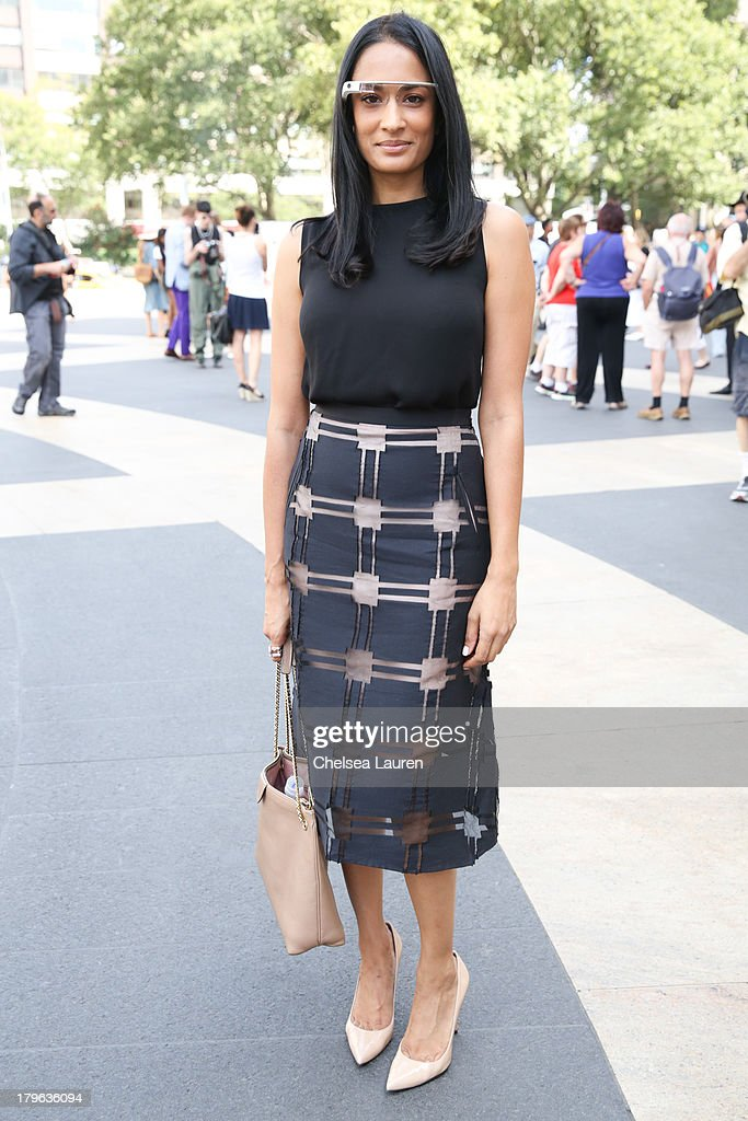 Blogger Prianka Patel is seen wearing a Tibi skirt, Theory shirt, Stuart Weitzman shoes, a Marc Jacobs purse and Google Glass on the Streets of Manhattan on September 5, 2013 in New York City.