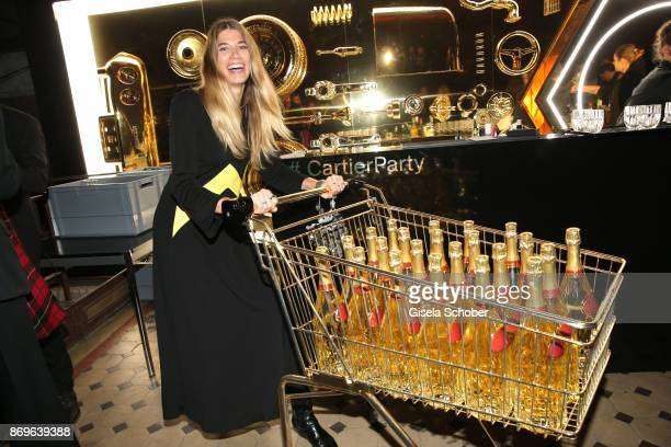Blogger Veronika Heilbrunner with a cart of champaign during the 'When the Ordinary becomes Precious #CartierParty Berlin ' at Old Power Station on...