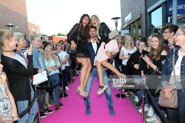 Blogger Xenia Overdose Thore Schoelermann and Milena Le Secret during the late night shopping at Designer Outlet Soltau on August 4 2017 in Soltau...
