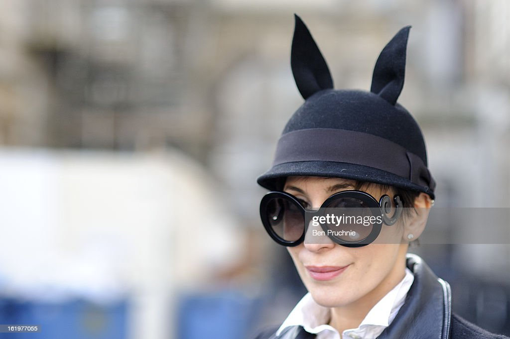 Blogger Xenia Xenothonpas poses wearing a Run Wild hat Valentino bag Zara coat and shoes with Prada sunglasses at Somerset House during London...