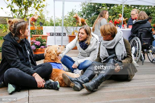 Blogger Yvonne Homann Purina manager Susanne Munz with an assistance dog and blogger Annalena Huppert during the Purina and Vita Event on September...