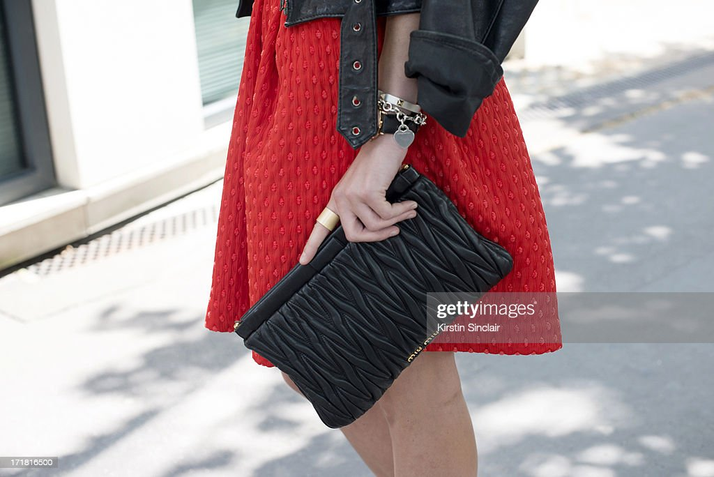 Blogger Zina Charkoplia wears a Miu Miu bag, an H and M skirt and a Vintage jacket on day 3 of Paris Collections: Men on June 28, 2013 in Paris, France.
