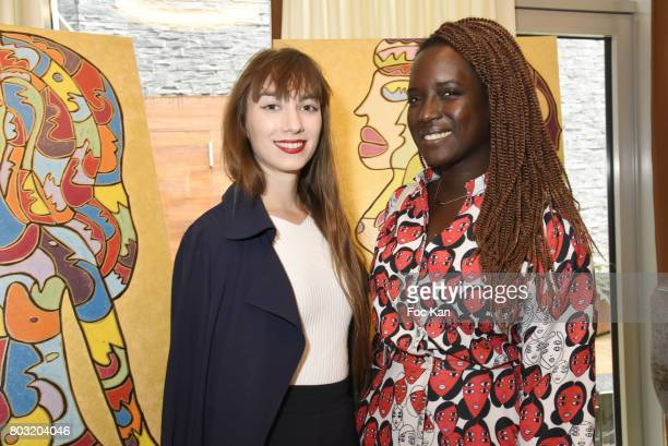 Bloggers Hermine Chanteau and Fatou Dem attend the Dimensions Lee Michel Exhibition Preview at Hotel Rennaissance on June 28 2017 in Paris France