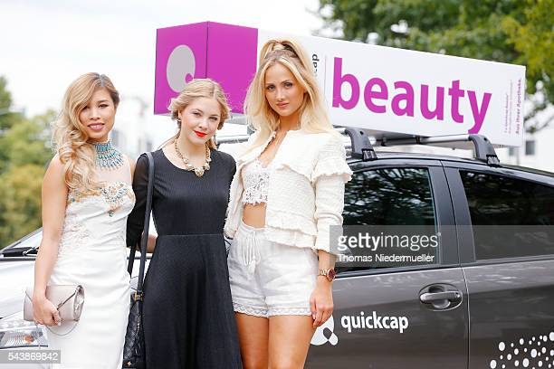 Bloggers Kisu Diana zu Loewen and Carmen Mercedes and a Quickcap car during the MercedesBenz Fashion Week Berlin Spring/Summer 2017 at Erika Hess...