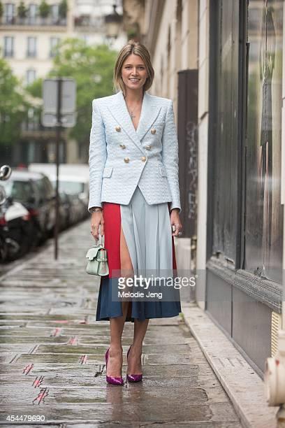 Blogger/Socialite Helena Bordon wears a Balmain blazer Cris Barros skirt Christian Louboutin heels Carla Amorim jewelry and a Delvaux purse at Jean...