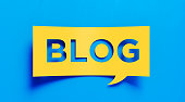Yellow blog text over blue background. Horizontal composition with copy space. Great use for blogging concepts.