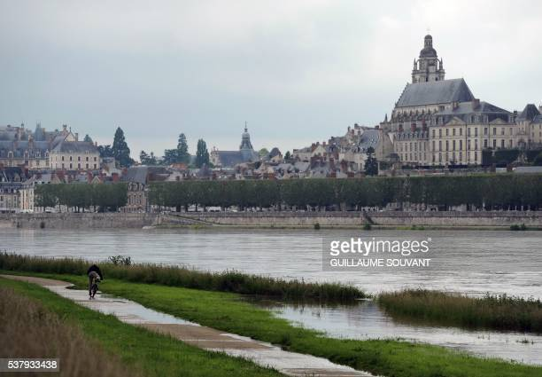 Blois and the Loire river are pictured on June 3 2016 following heavy rainfalls In LoiretCher department 180 road agents are at work and half of the...