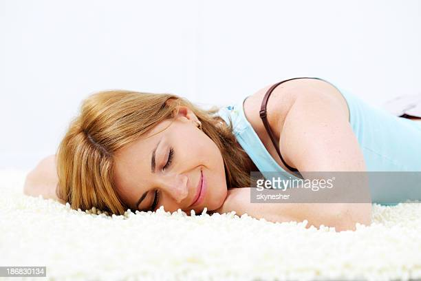 Blond beautiful woman sleeping on the floor.