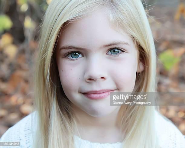 Blond blue eyes serene expression autumn