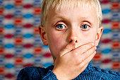 Blond boy makes the 'Speak no Evil' gesture