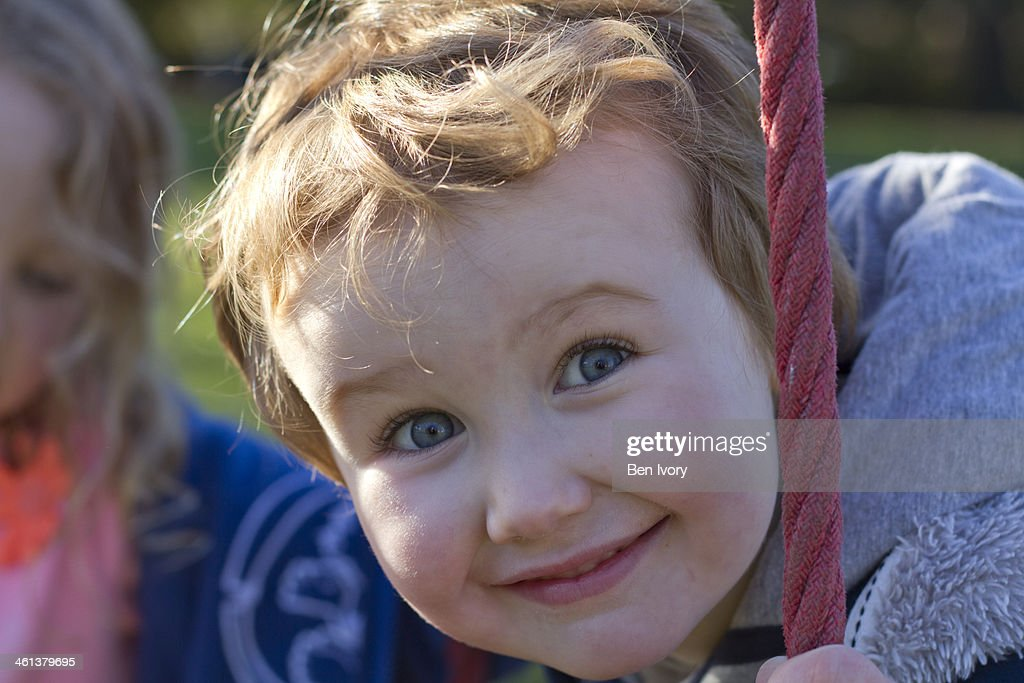 Blond boy smiling at camera : Stock Photo