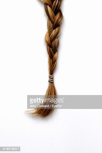 Blond Braided Hair Against White Background
