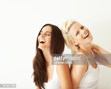 blond & brunette girls laughing together