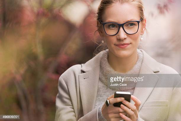 blond business woman checking on her phone
