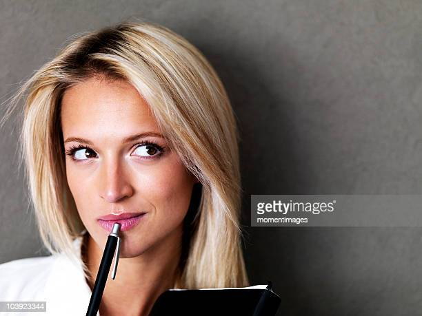 Blond businesswoman deep in thought