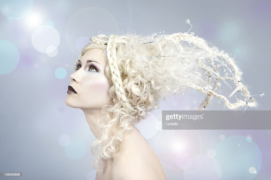 blond fairy looking at flying  lights