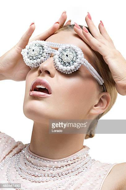 blond fashion model wearing pearl glasses