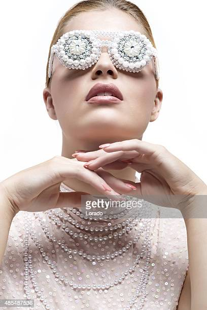 blond fashion model wearing pearl glasses