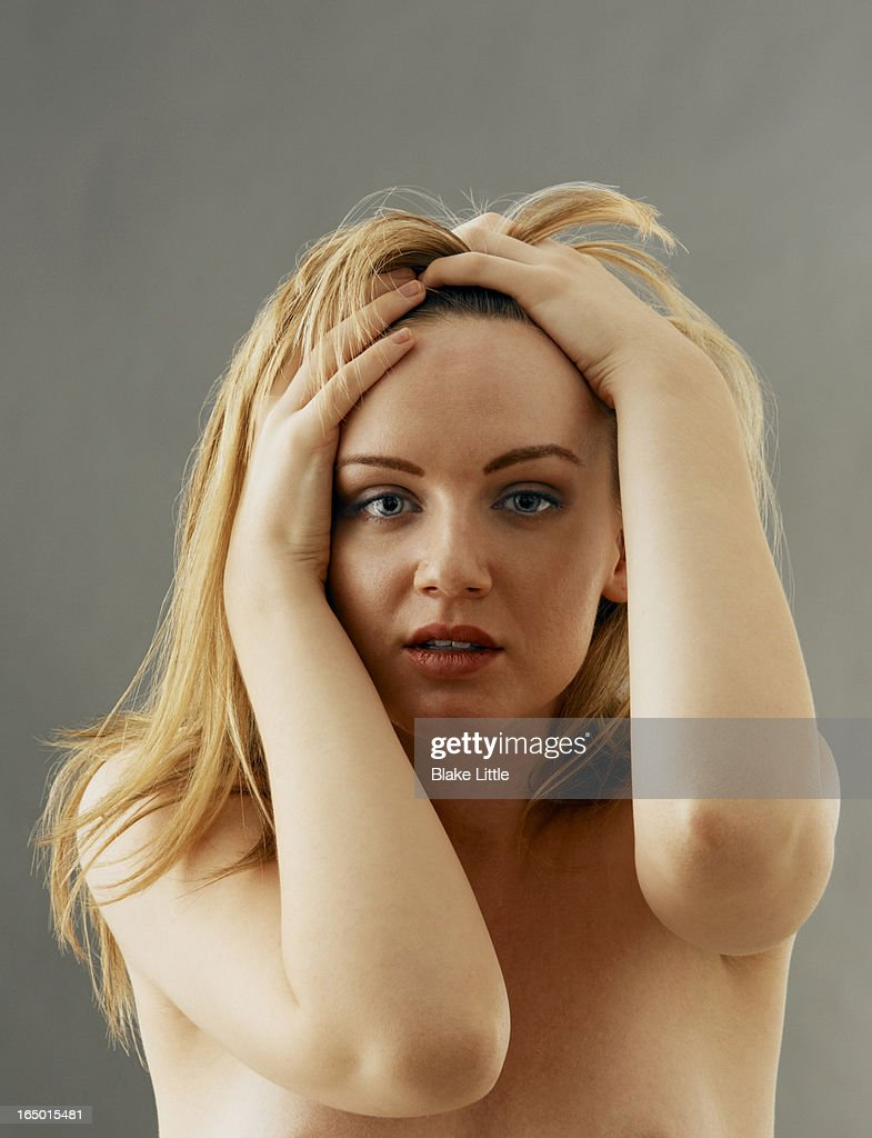 Blond Female holding head : Stock Photo