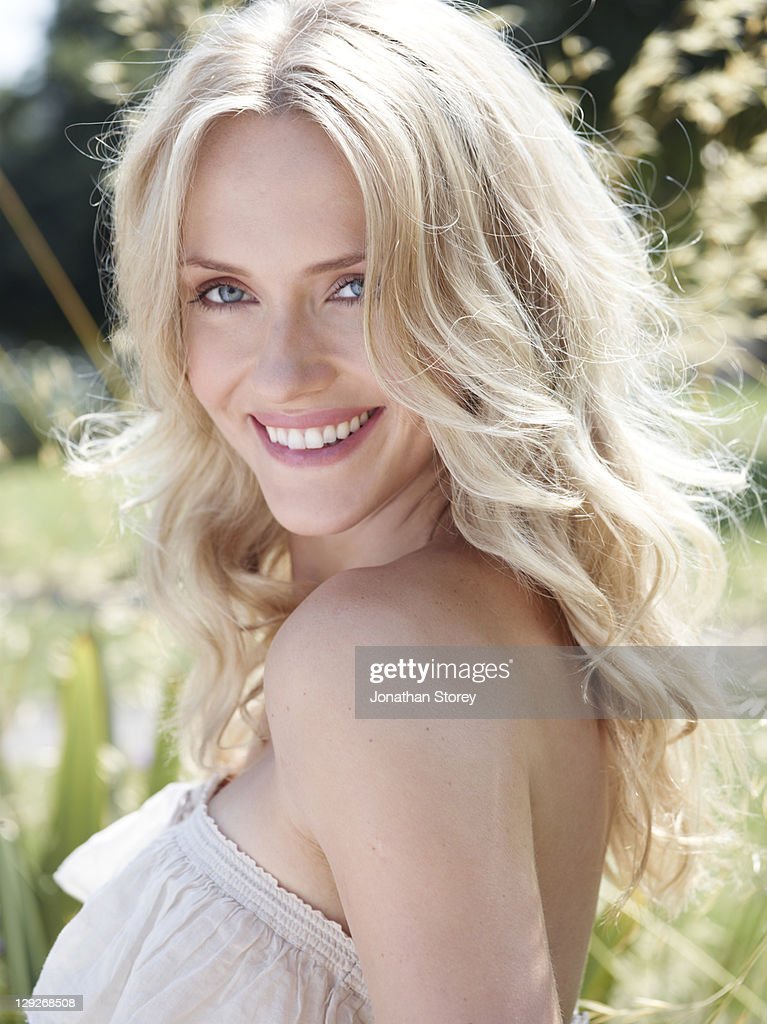 Blond female outside on a sunny day. : Stock Photo