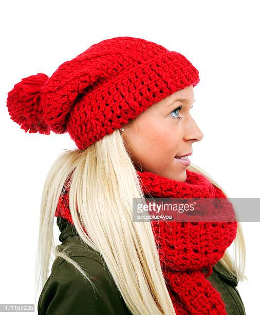 blond female with red poodle hat and scarf on white