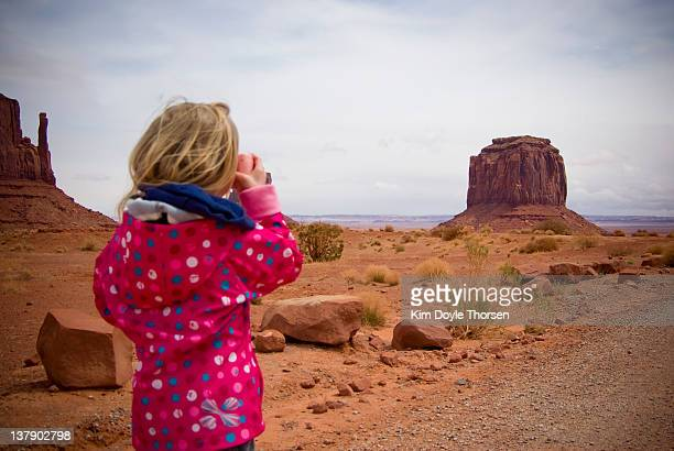 Blond girl child photographing Monument Valley