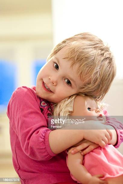 Blond girl embracing her puppet